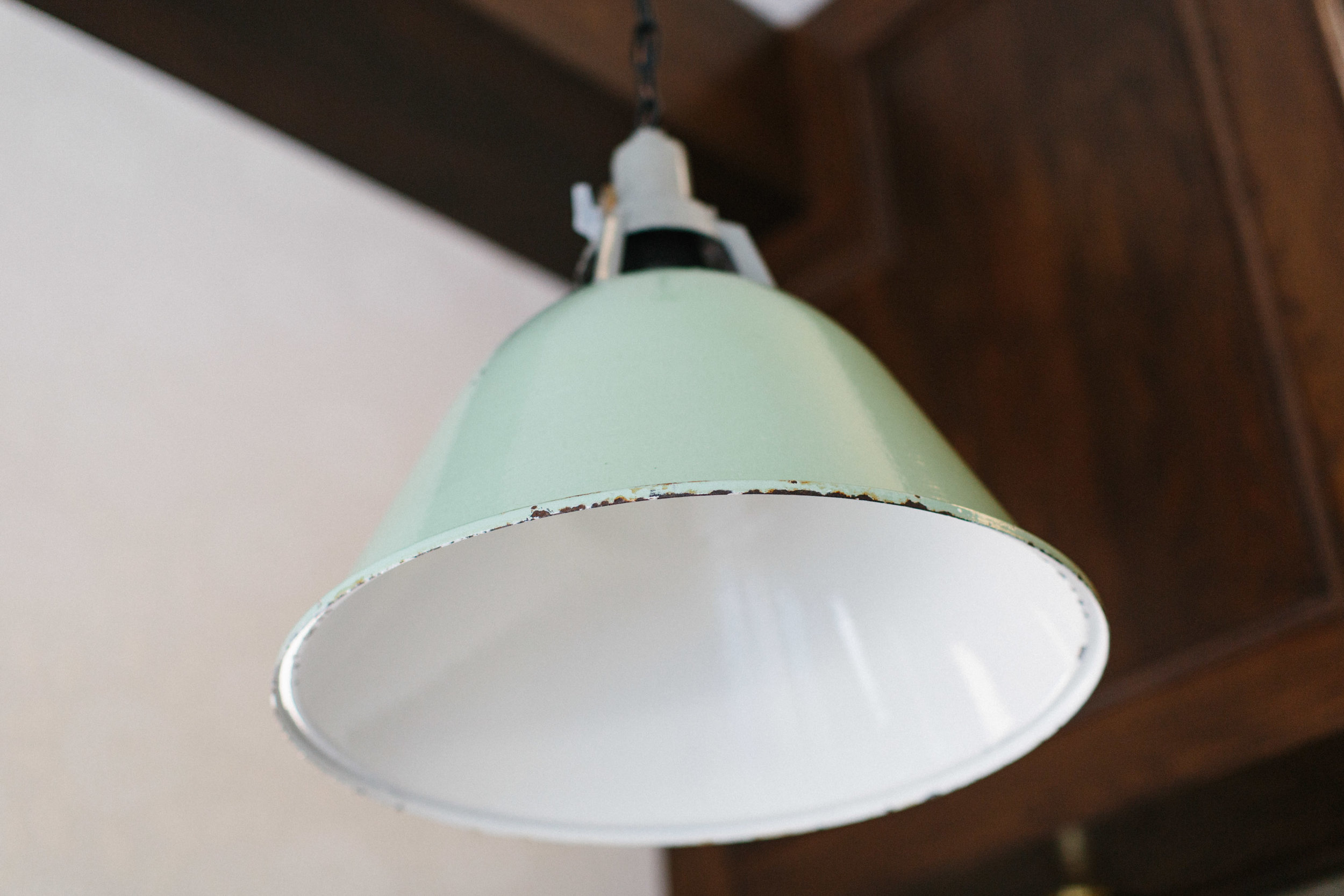 Close-up shot of green pendant light