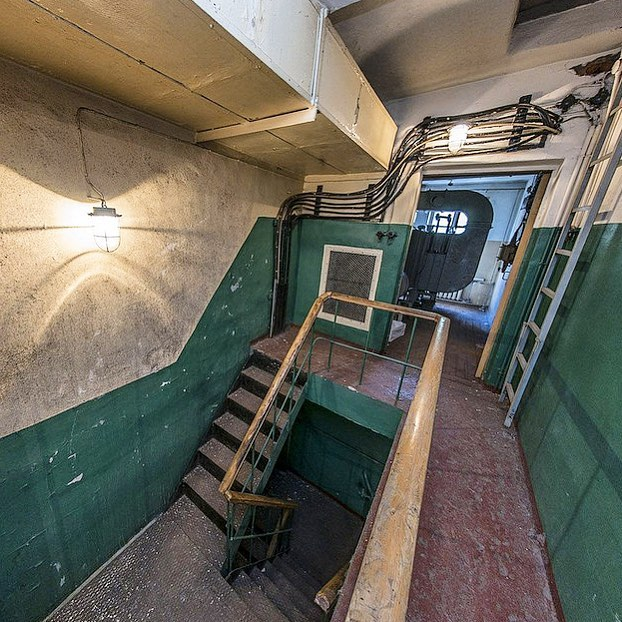 An abandoned stairwell that once led to an underground bunker that stashed secret documents for the Soviet Military of Foreign Affairs🤫 Our Parkwood Pine pendant, as shown here, was utilized in these types of buildings all over Russia💡We have hundreds available in multiple colors, all UL Listed✔️ Located in Minneapolis, MN check out our website👉🏼fixtelectric.com #oldlightsnewlife 📸:@lanasator