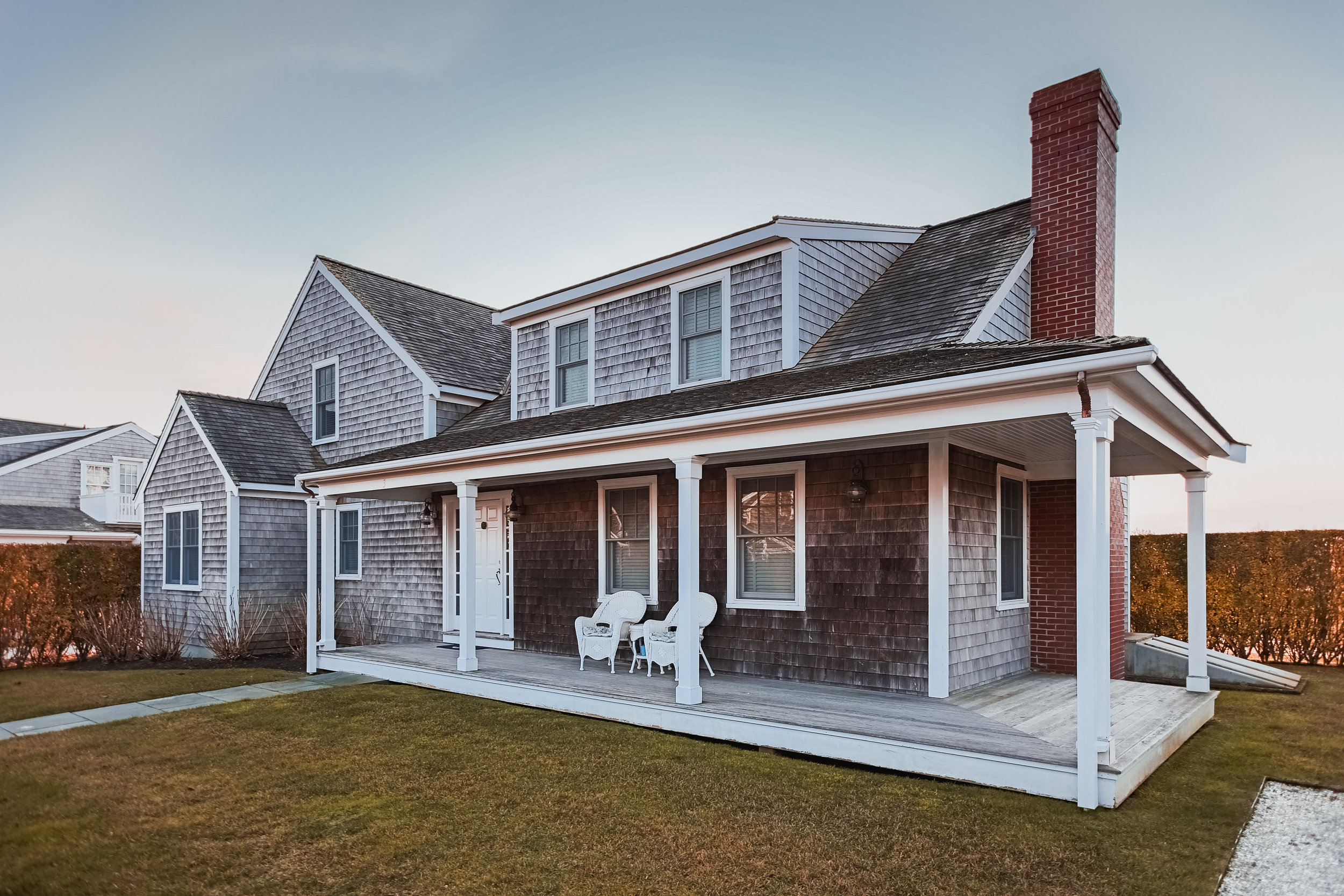 Beautiful traditional Nantucket ocean home. Only problem? Dead grass & overcast.