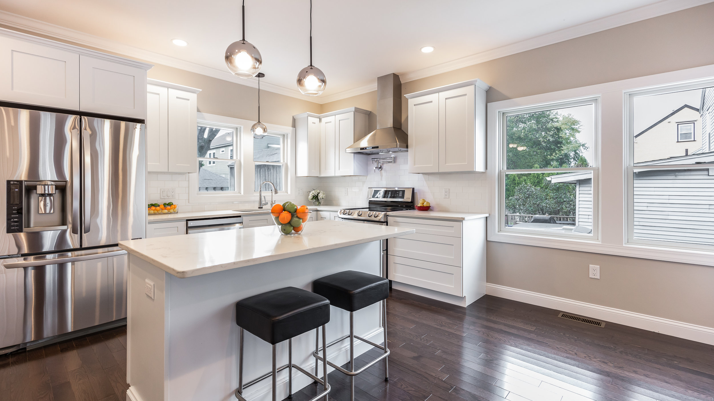 This was a really great open kitchen in a Cambridge townhouse. I love the dark floors with the bright white counters and cabinets