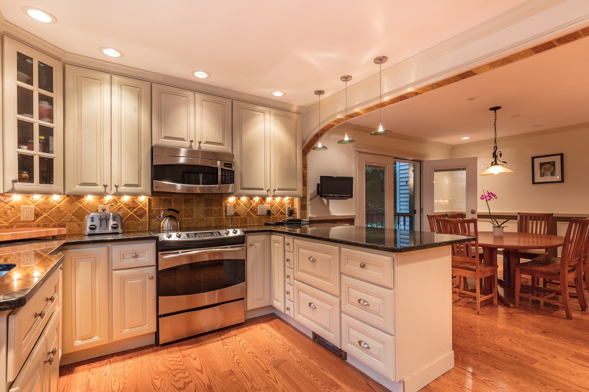I don't normally go for darker spaces, but this kitchen's lighting design made it stand out.