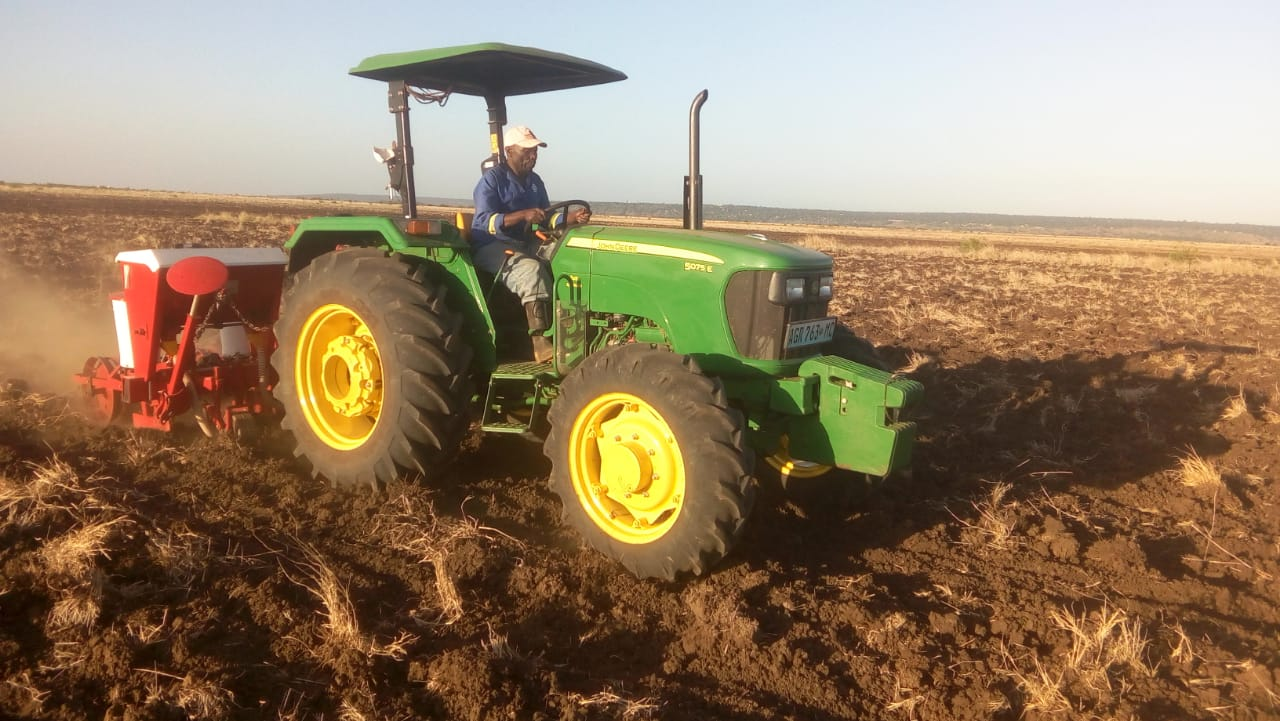 This is our tractor planting corn just before the rainy season