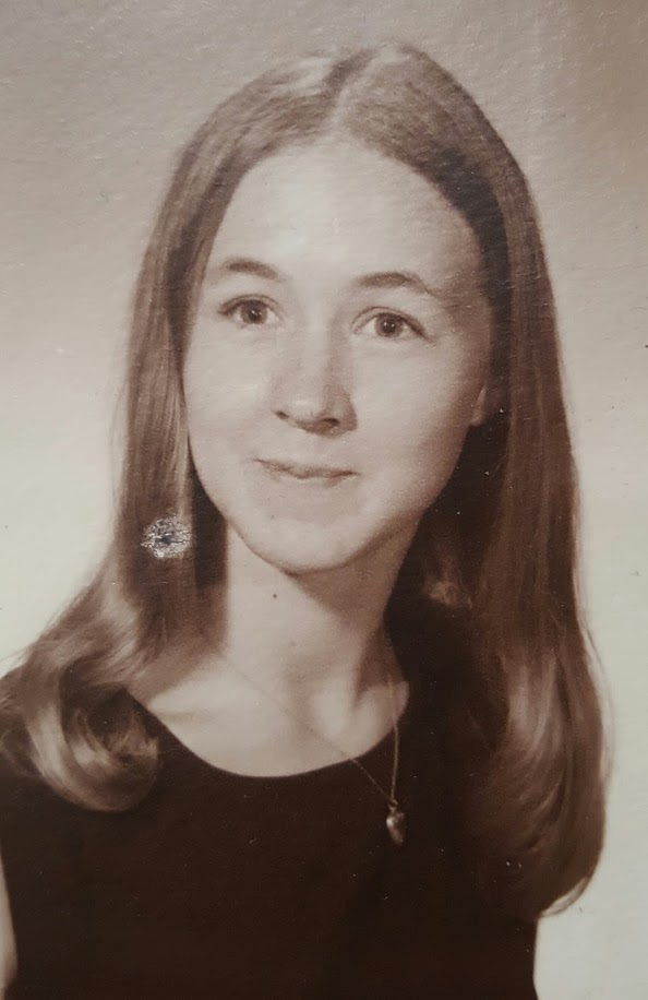 My mom, a few years before she had me. One of the few pictures of her smiling.