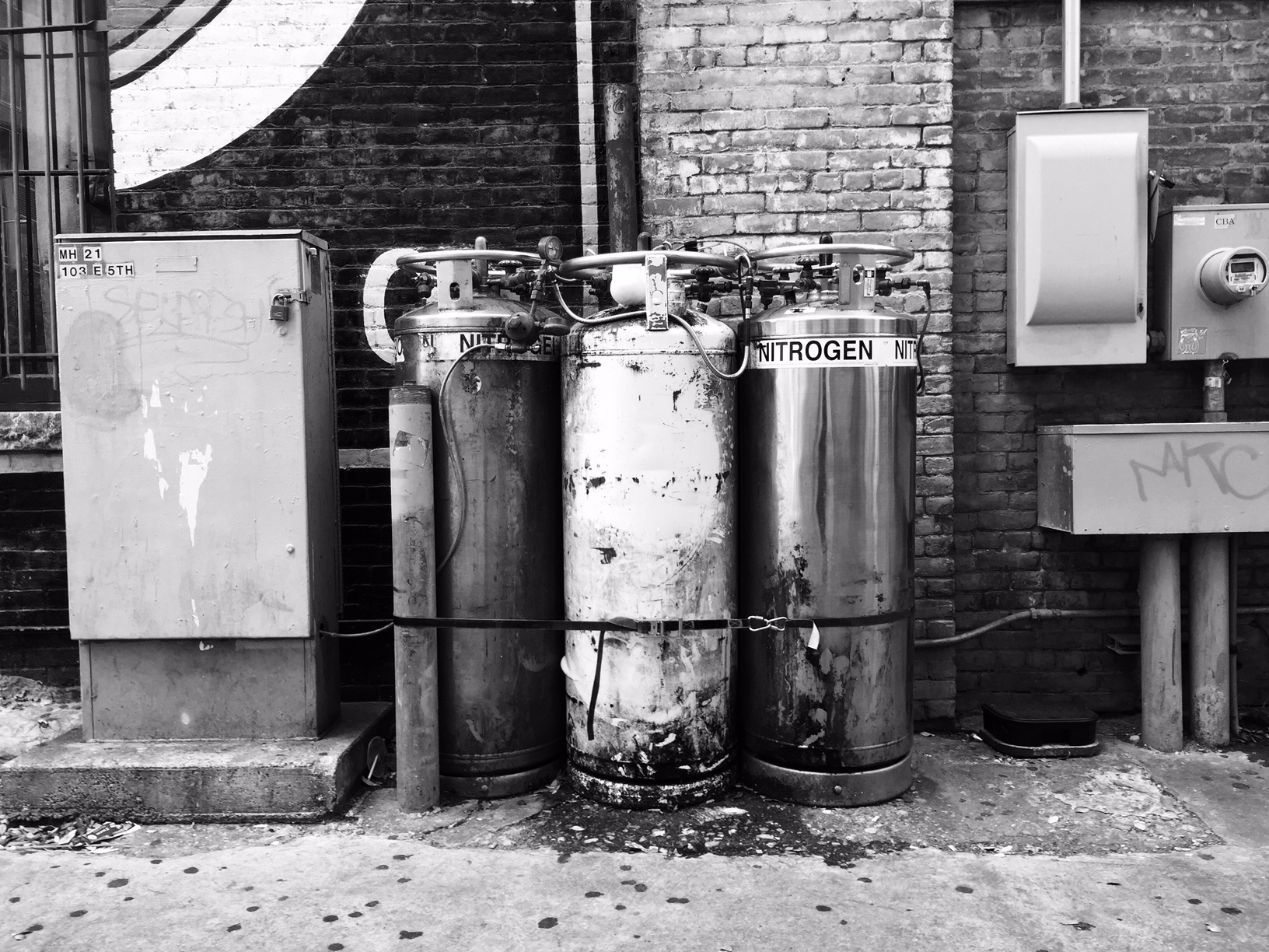 Urban alleys feature ad-hoc arrangements of energy sources, waste, and storage — some of questionable proximity.