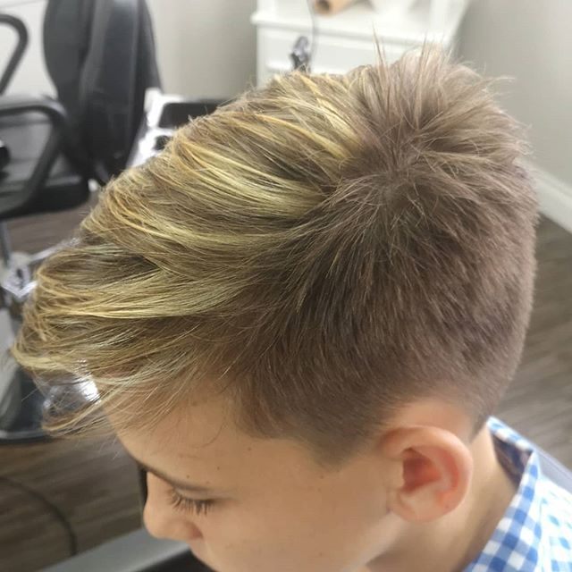 It's summer 🌞 time and this handsome fella is headed on a big football ⚽ tour with his club, we vamped him up with some fun highlights #salon101rocks #footballhair #boyscandyetheirhairtoo
