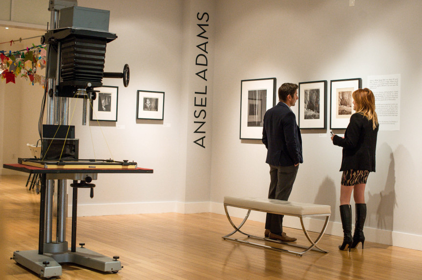 "Tish Greenwood, right, executive director of the California Museum of Art Thousand Oaks, and Tony Principe, board of directors chair, look over their new exhibit ""In Focus: Ansel Adams Highlights from Lawrence Janss Collection"" on Tuesday, February 19, 2019 at the Thousand Oaks Mall. (Photo by Sarah Reingewirtz, Pasadena Star-News/SCNG)"