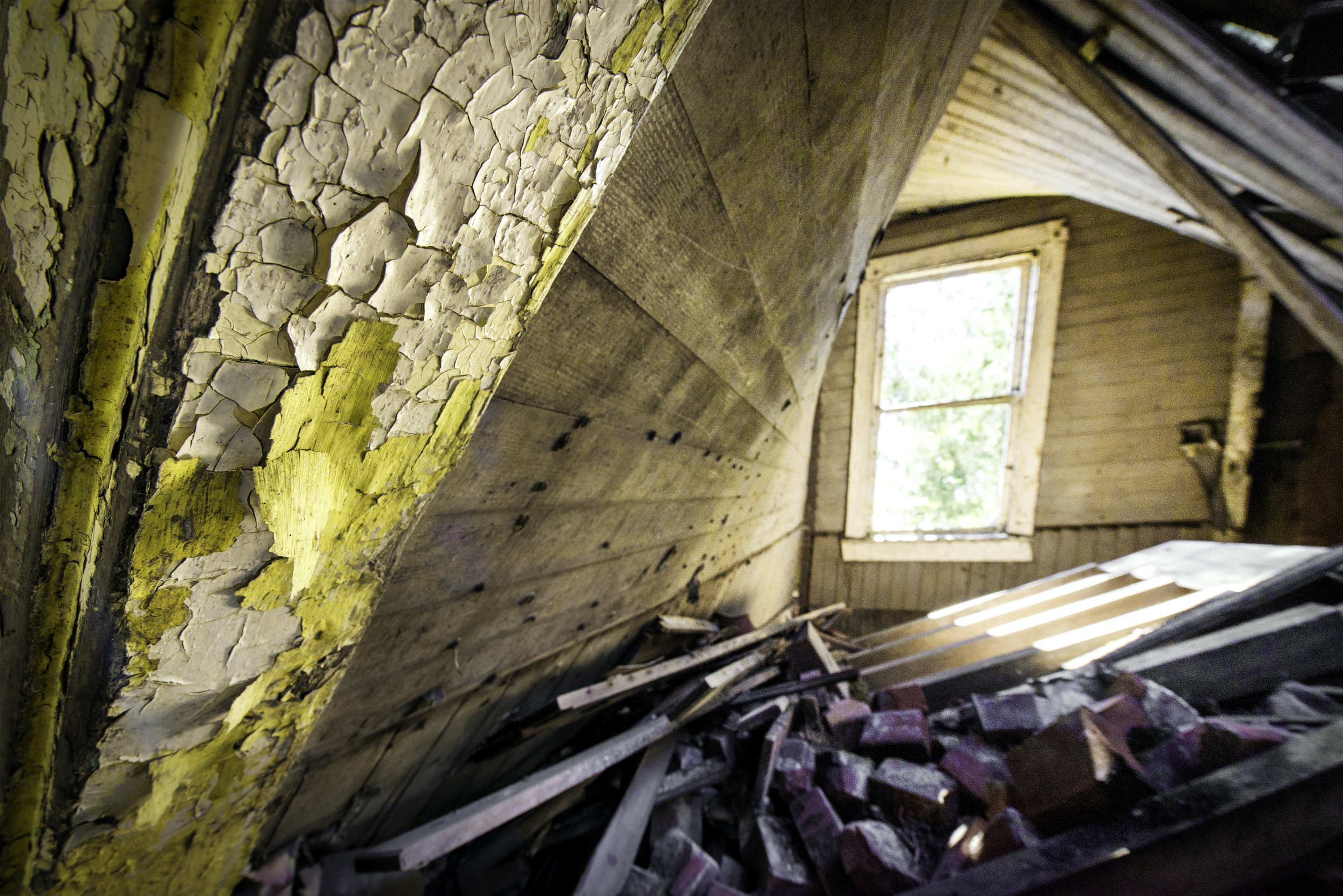 A decrepit old piano lies face down in the ruins of this slanted house