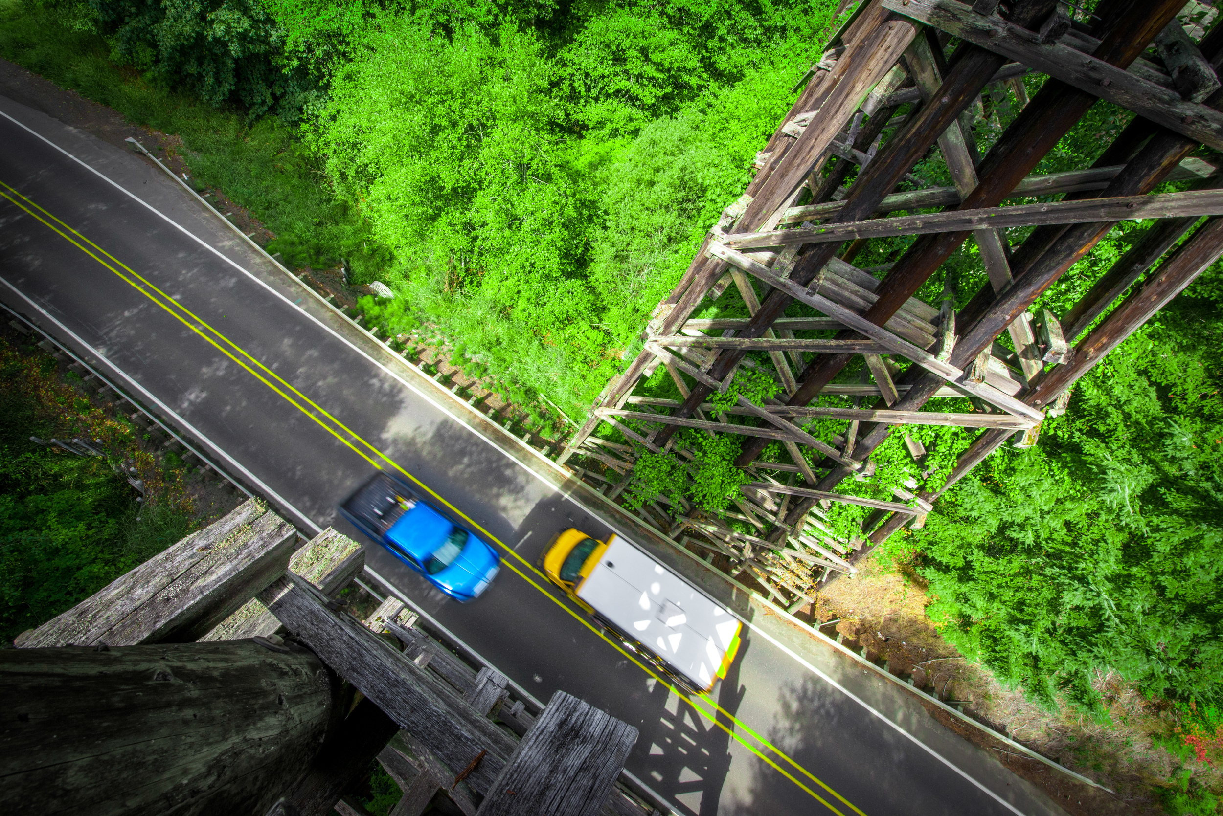 View of the cars from an abandoned rail bridge in Vernonia, OR