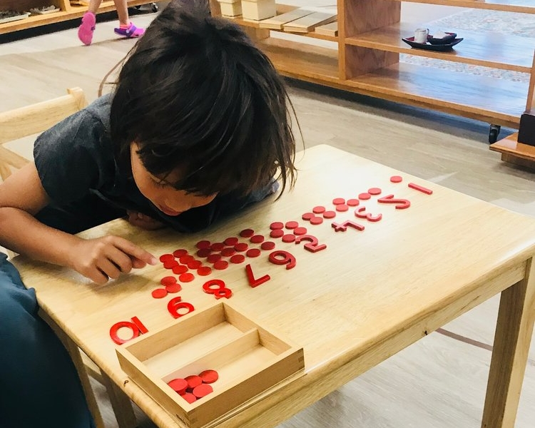Child working with math material