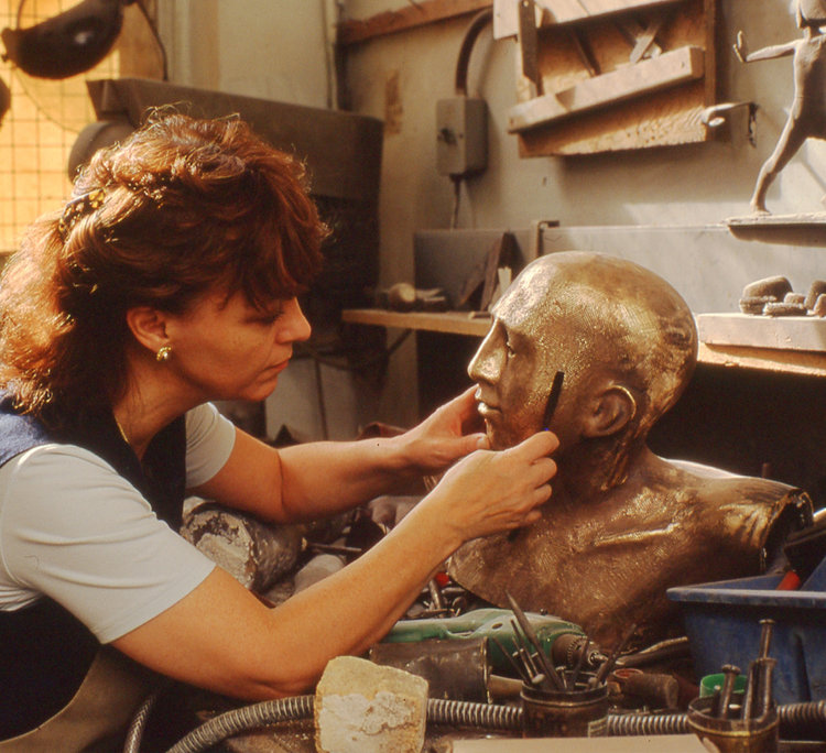 """Philomena working on a sculpture in bronze titled """"Fairway"""" commissioned by Sir Peter Michael CBE for Donnington Valley Hotel & Golf Course, Newbury, UK."""