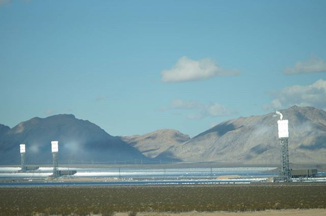 Ivanpah Solar Plant, California:  The mysterious site, partly owned by google inc. uses more than 170,000 mirrors mounted to the ground to reflect sunlight to 450-foot-high towers. These towers are topped by boilers that heat up to create steam, which in turn is used to generate electricity.  This particular photo depicts an accident in May 2016 in which some mirrors were angled toward a level on the tower not designed to harness energy, and caused a small fire.  The site has received further criticism after it was discovered that the reflection from the mirrors was killing thousands of birds.  #solarpower #solarpanels #renewableenergy #sustainability #civilengineering #greenenergy #california