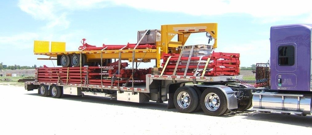 Another Colorful Load of Trailers Heads Out!