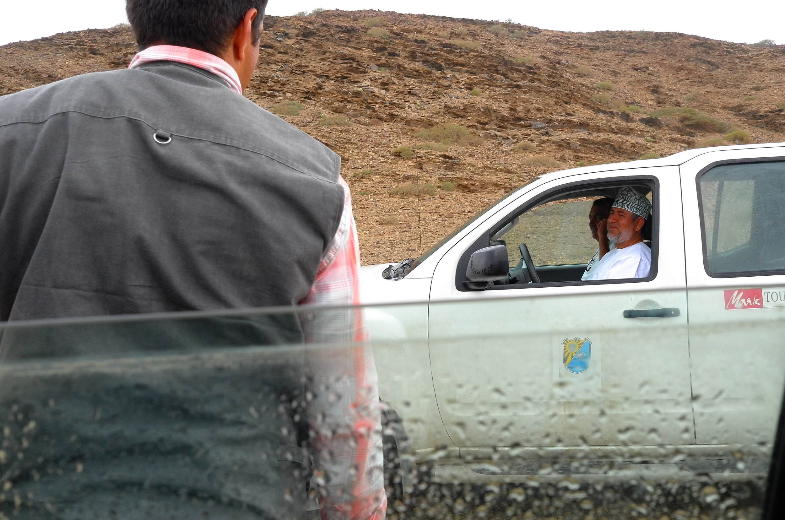 Omani drivers and  guides wait  for hours until all the students are done with their field trips  everyday .