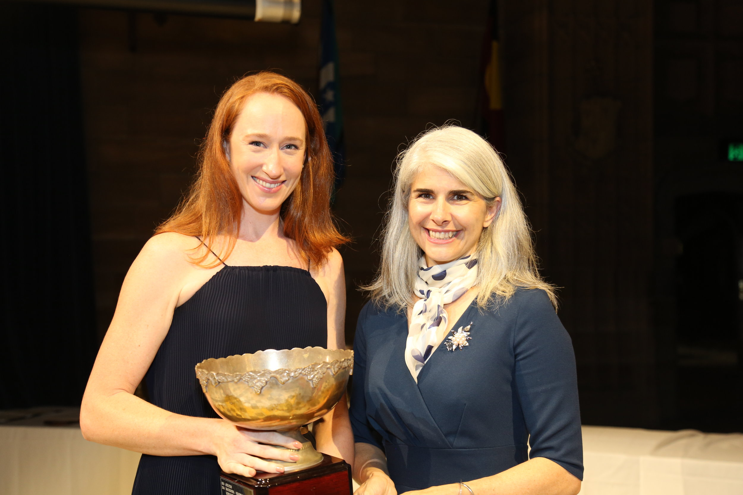 Boat Club President Sarah Cook accepts the Ann Mitchell Trophy at the 2018 Sydney Uni Sports Awards