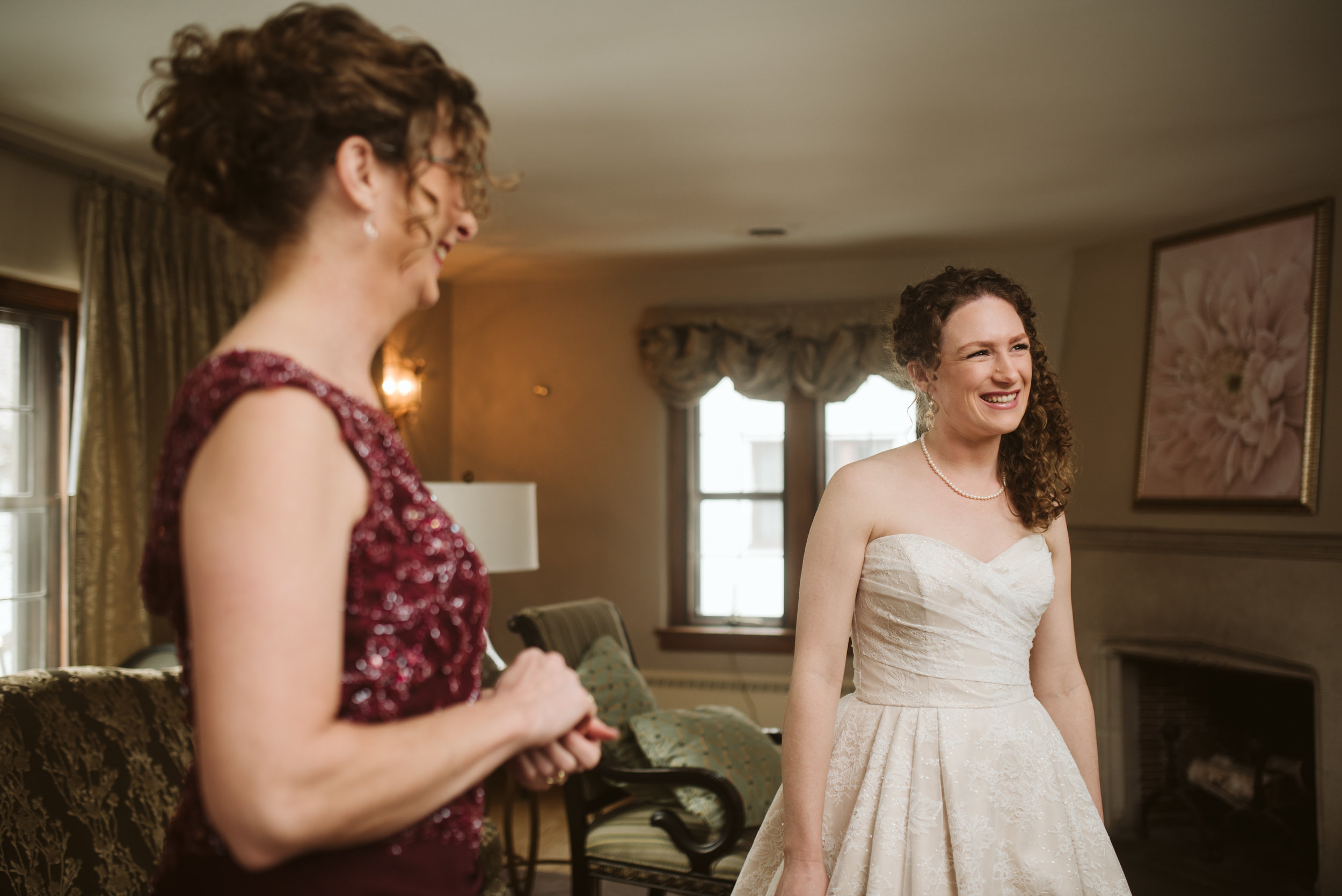 Bride and mother of bride laughing