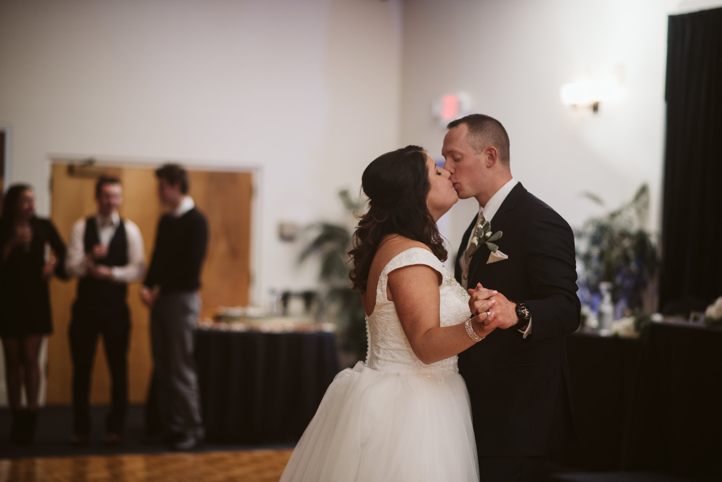 Bride and groom kiss during first dance in Michigan