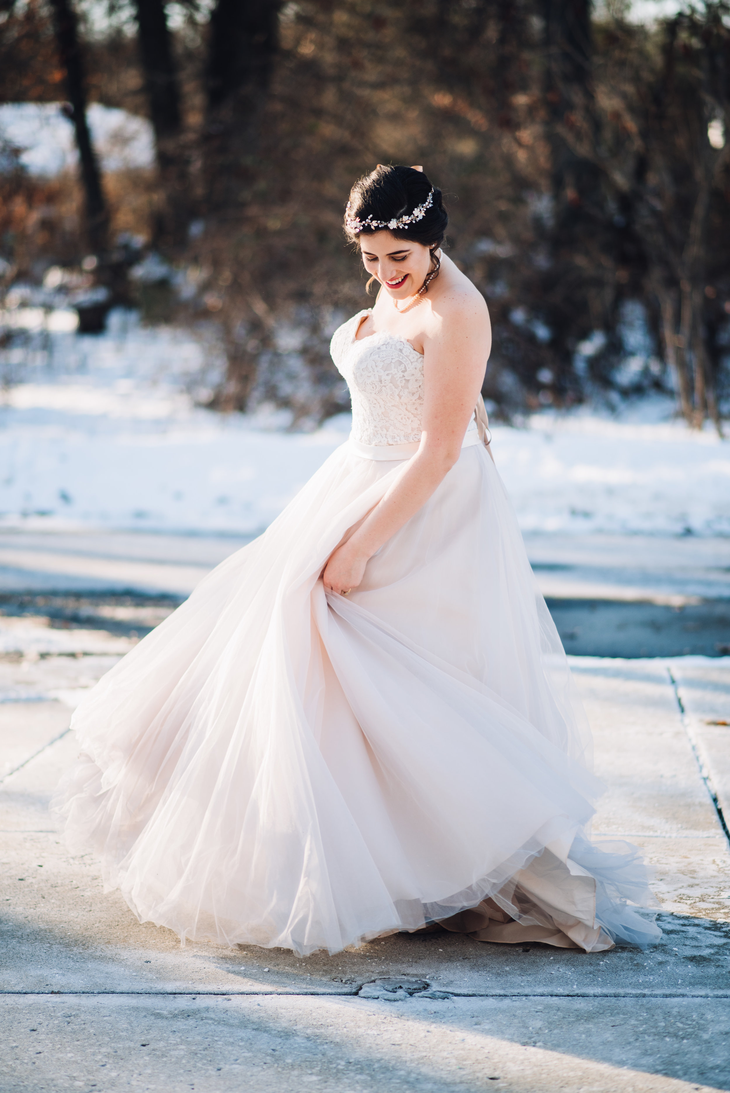 Bride dancing in the snow