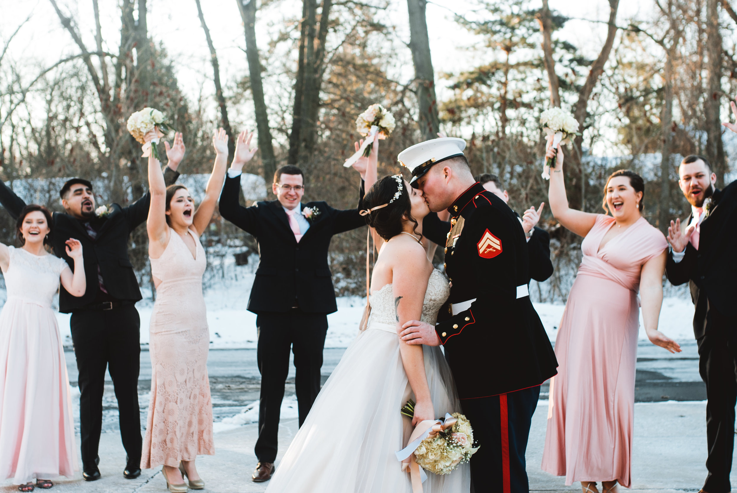 Bridal party cheering for bride and groom