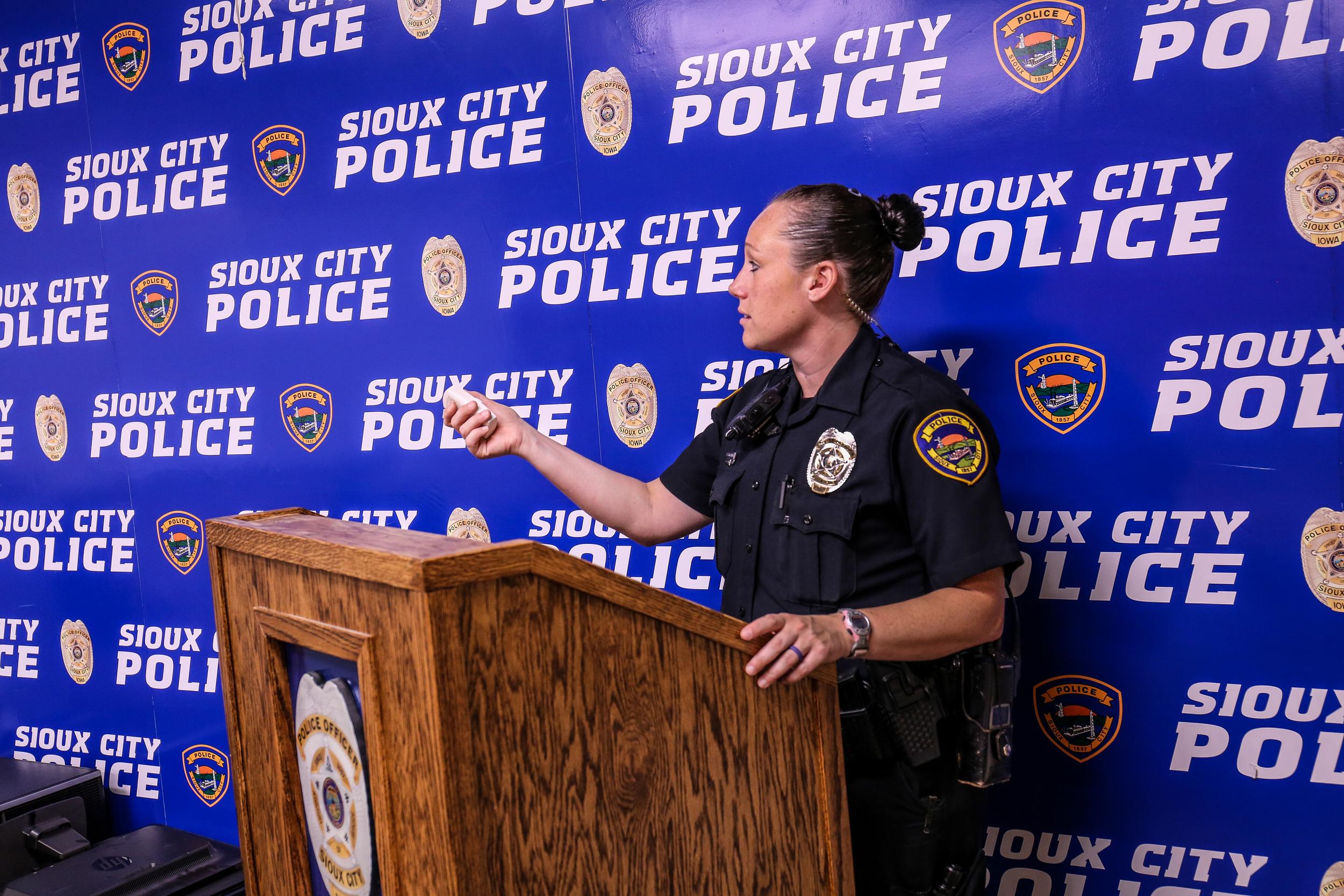 Officer Elisha Schmeckpeper conducts a presentation in Davidchik Hall.