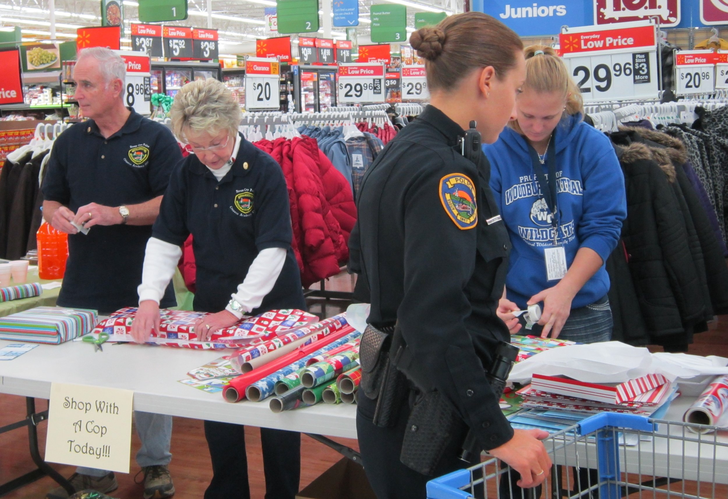Volunteers, Aleck and Marlene, helping with Shop with Cops event