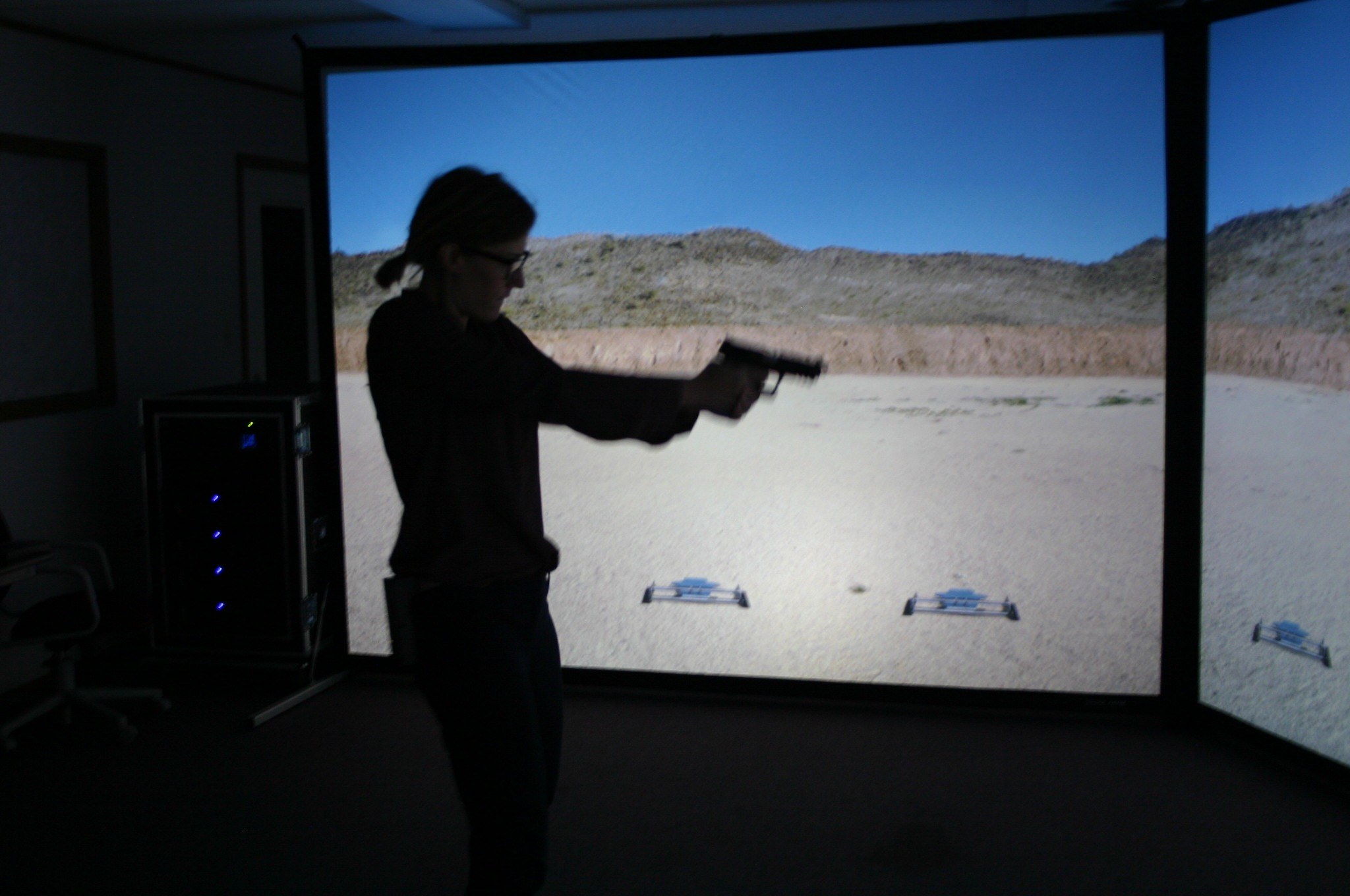 A participant uses the VIRTRA trainer which project images on a 180 degree screen.