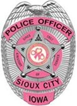 Officers can also purchase for wear a pink version of the department's badge.