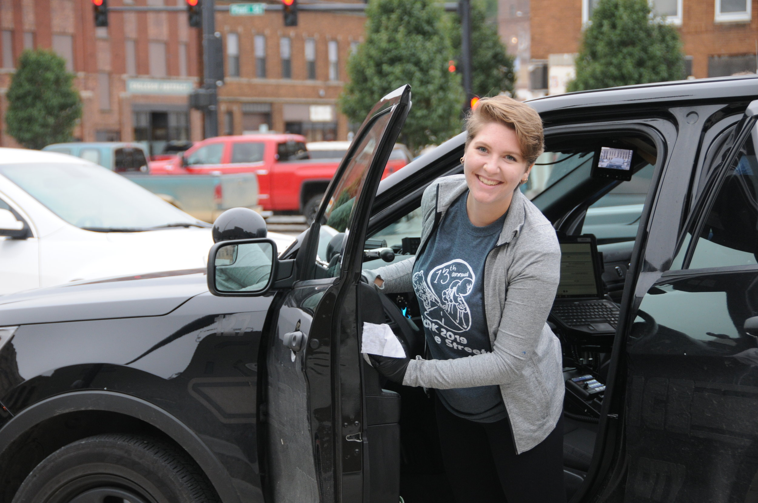 Kailyn Roberts, a senior at Morningside College and student president of the Morningside Civic Union, helps clean a patrol car at the police department on Oct. 2. The students volunteered their time as part of Morningside College's Into the Streets annual volunteer project.