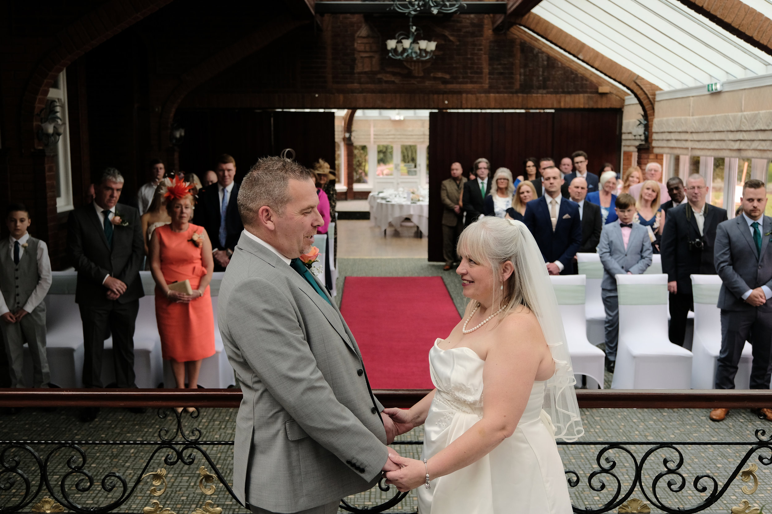 Warwickshire Wedding Photographer Ardencote Manor House 07 - married couple with guests.jpg
