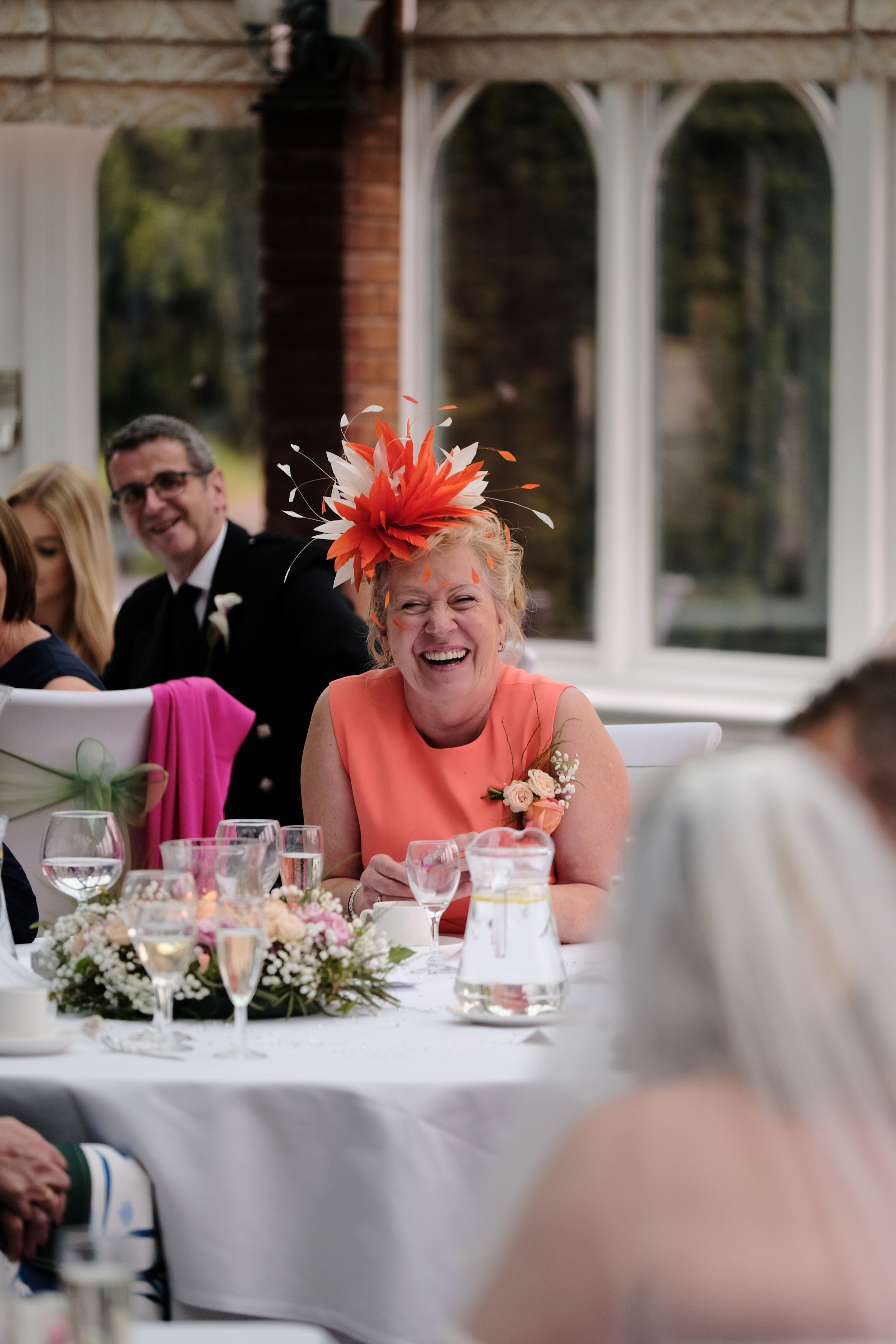 Warwickshire Wedding Photographer Ardencote Manor House 29 - mother of the groom candid portrait laughing.jpg