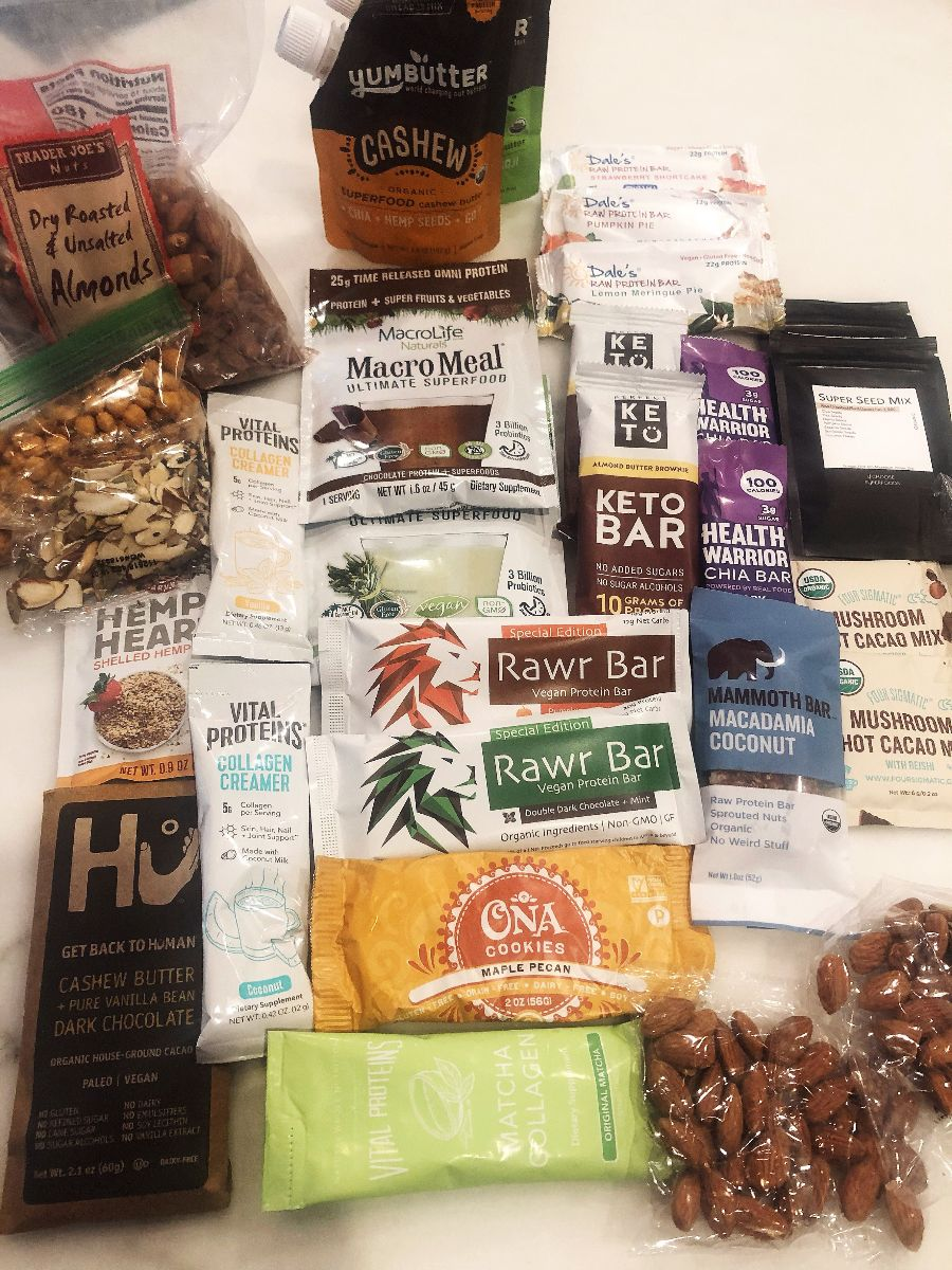 Here is a pic of my travel snacks! There are a few additional products not listed above like Trader Joe's salad toppers,  hemp hearts  (great source of healthy fat and protein on salads),  Hu chocolate  and Vital Proteins Collagen Coffee Creamers as well as  Four Sigmatic Mushroom Hot Cacao .