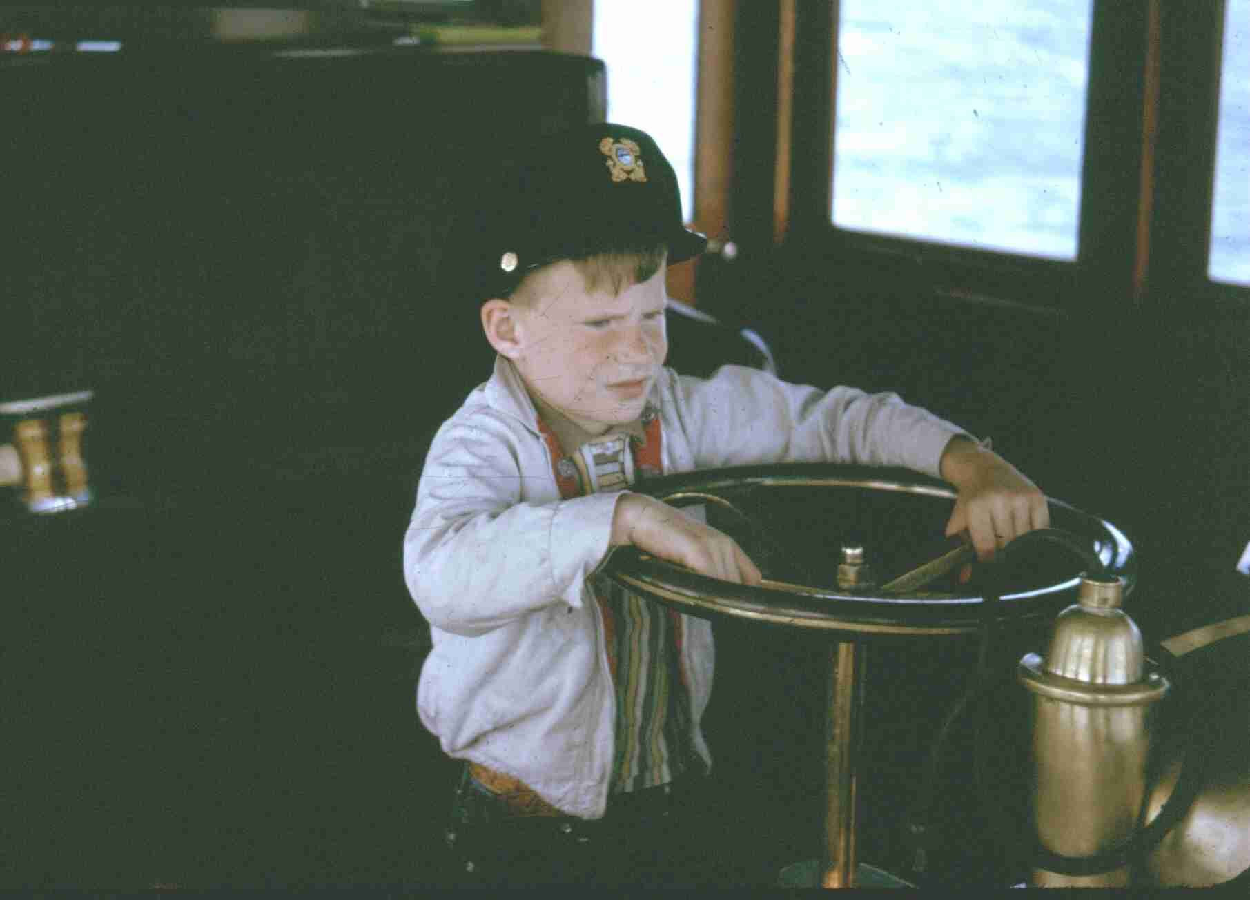 Otto as a child, ready at the helm