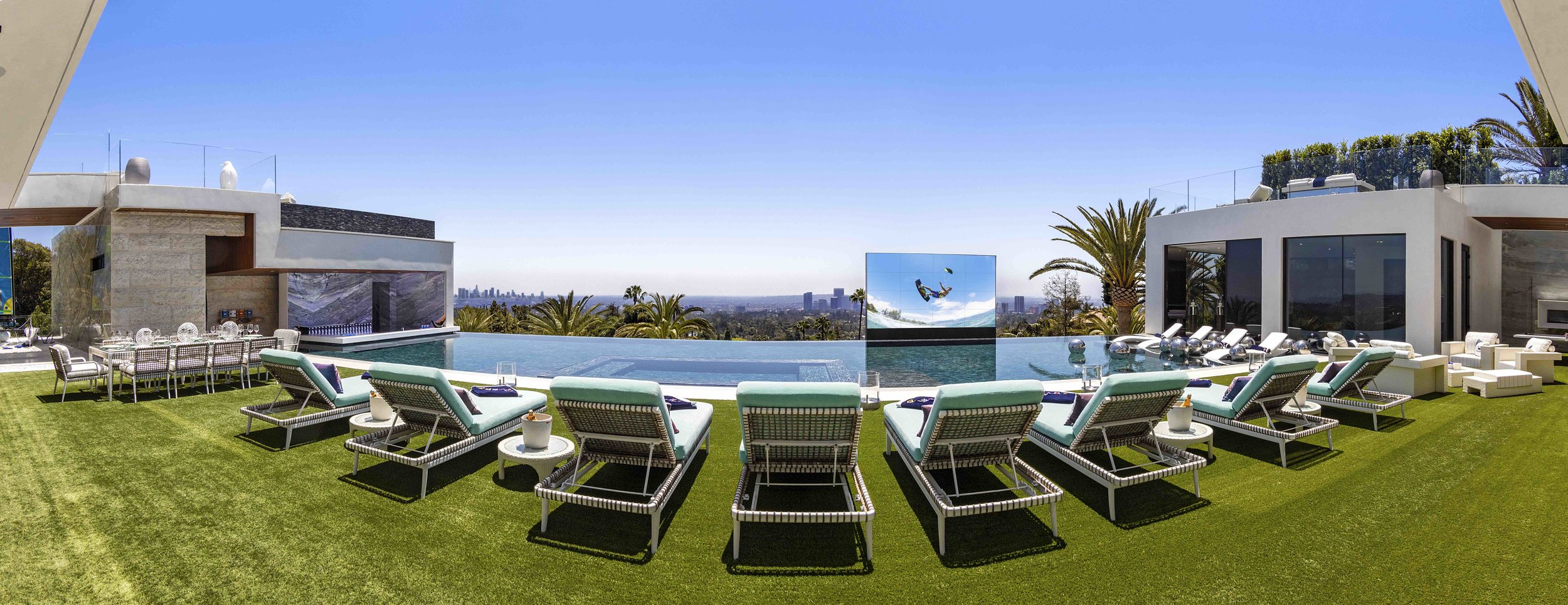 The pool features a swim-up bar and a special hydraulic TV screen