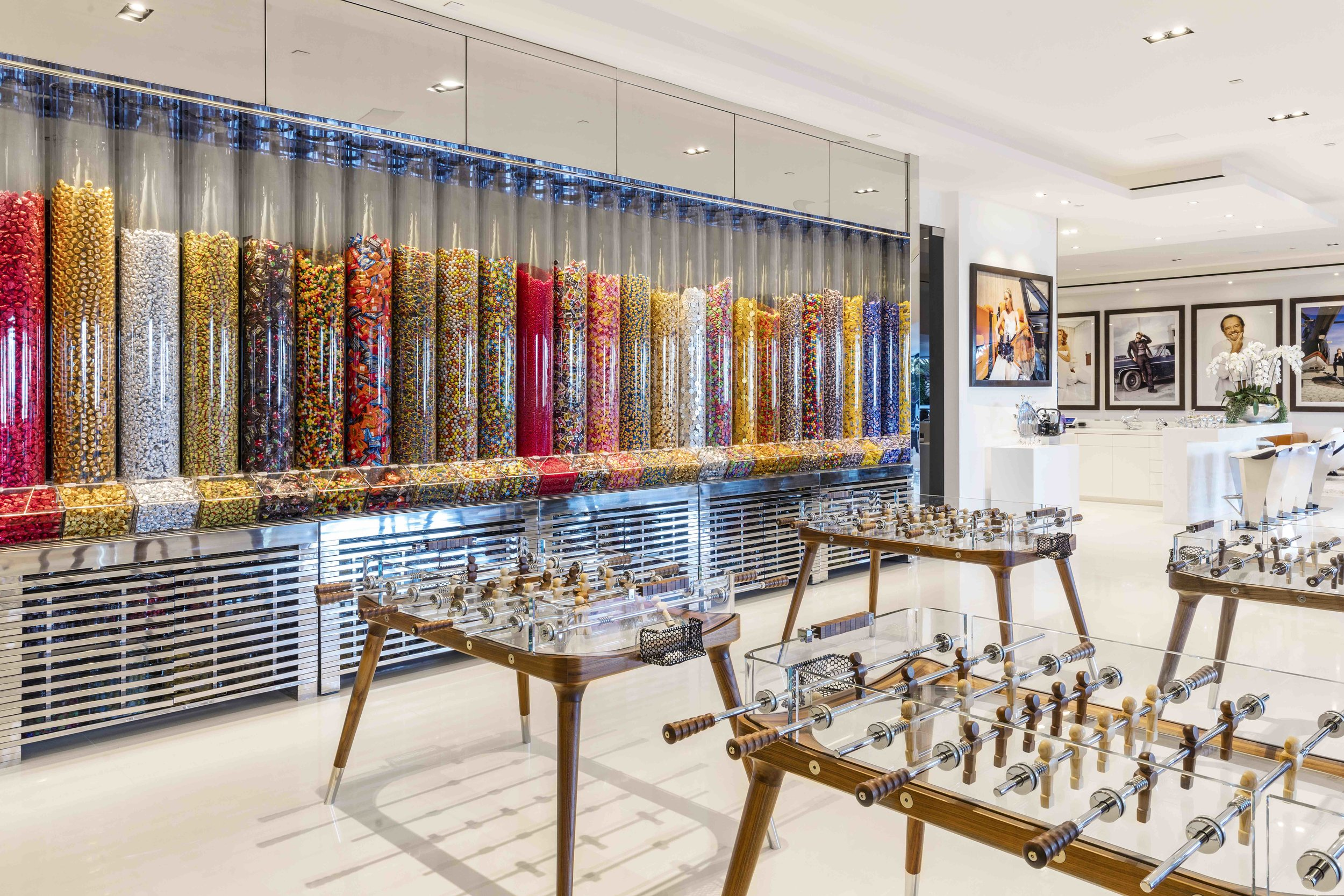 The ground floor includes custom glass ping pong and foosball tables, as well as a wall-mounted candy dispenser