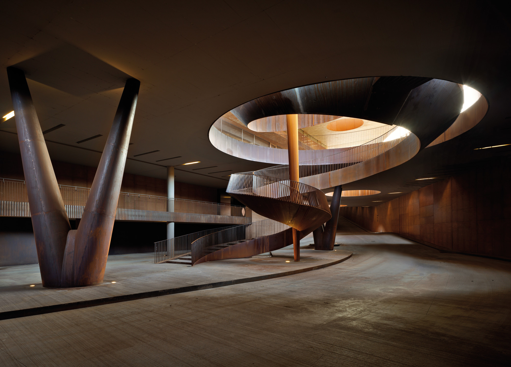 The twisting, free-floating staircase leads visitors to the podium level