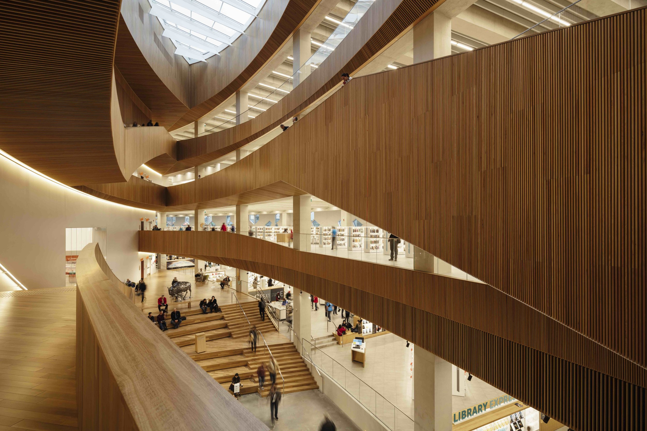 The oculus and central atrium allows natural light deep into the building. Photo by Michael Grimm