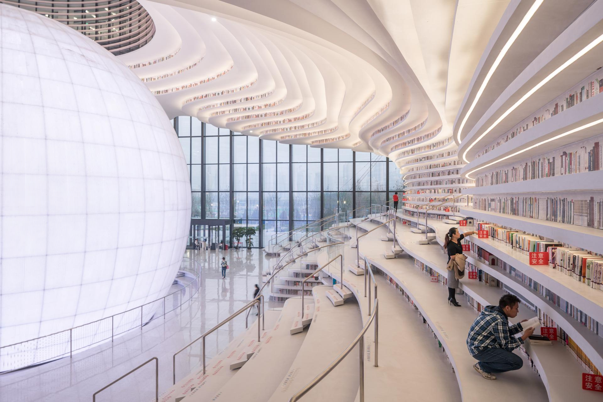 Contoured terraces provide access to the stacks at the Tianjin Binhai Library, photo by Ossip