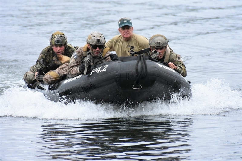 A SEAL team jumped from a helicopter Saturday into Newfound Lake and then sped to the beach at Wellington State Park.(Bea Lewis/Union Leader Correspondent)