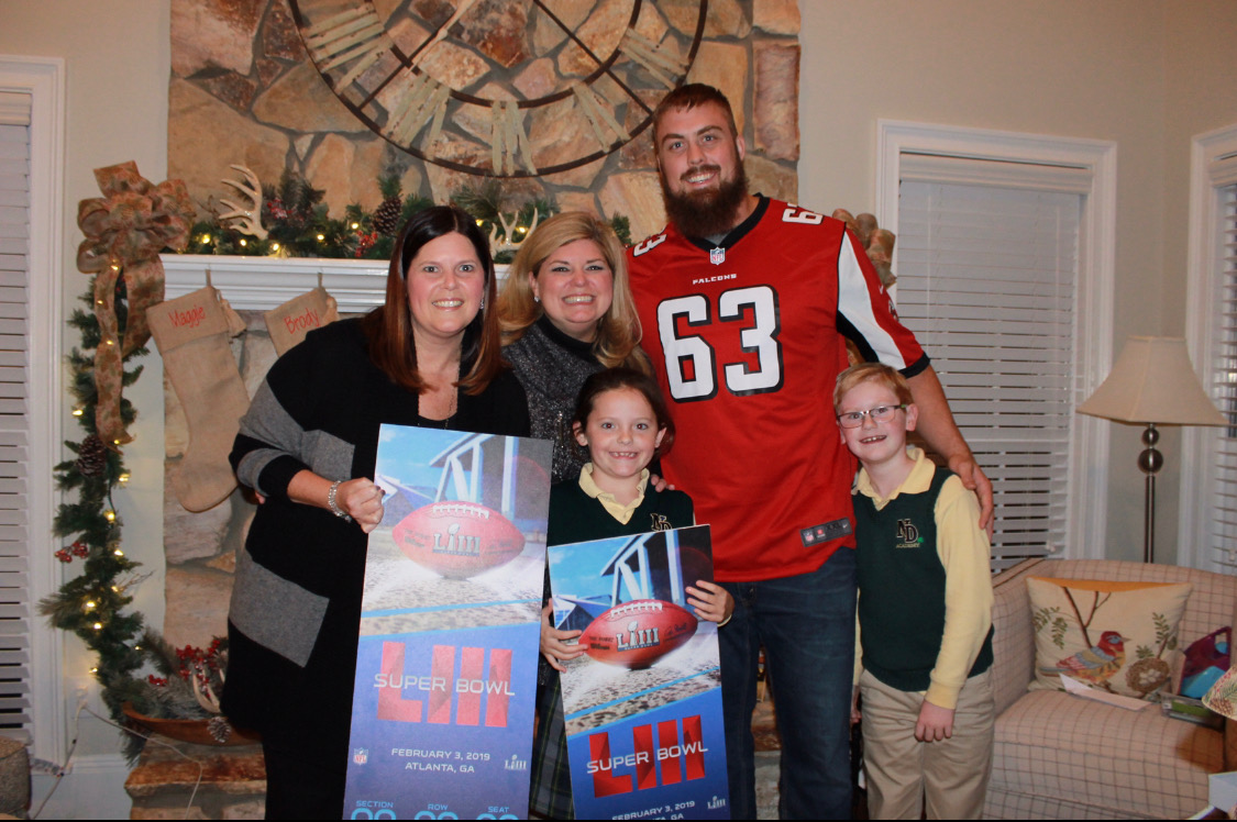 Kami Kennedy (left) was given Super Bowl tickets by Atlanta Falcons player Ben Garland (right) to honor her work raising money for the Fallen Patriots Foundation. (Special Photo)
