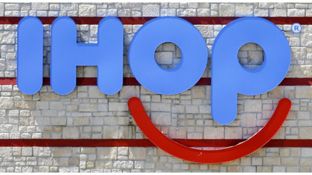 "FILE- This May 11, 2017, file photo shows an IHOP sign at a restaurant in Hialeah, Fla. IHOP, which teased a name change to IHOb earlier this month, says the ""b"" is to promote its burger menu. (AP Photo/Alan Diaz, File)"
