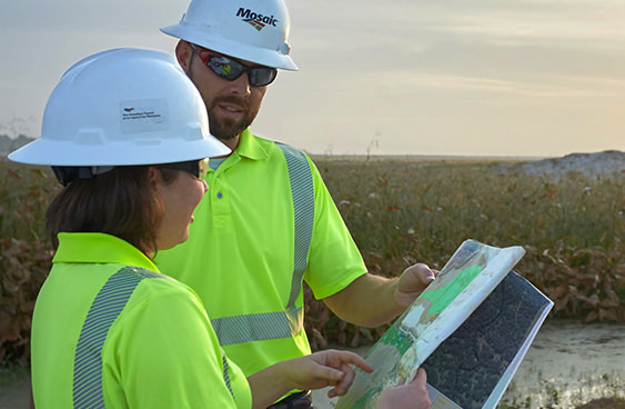 Mosaic Company employees looking at plans on a Florida reclamation site