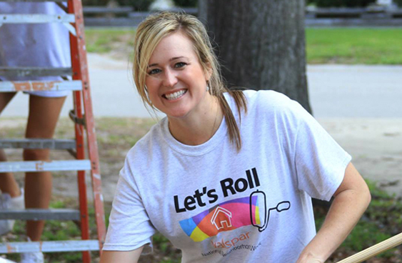 Volunteers wearing Valspar Let's Roll t-shirts at a Habitat for Humanity National Neighborhood Week home restoration project