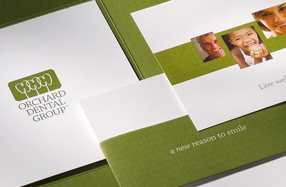 Orchard Dental Group brand identity on stationery system