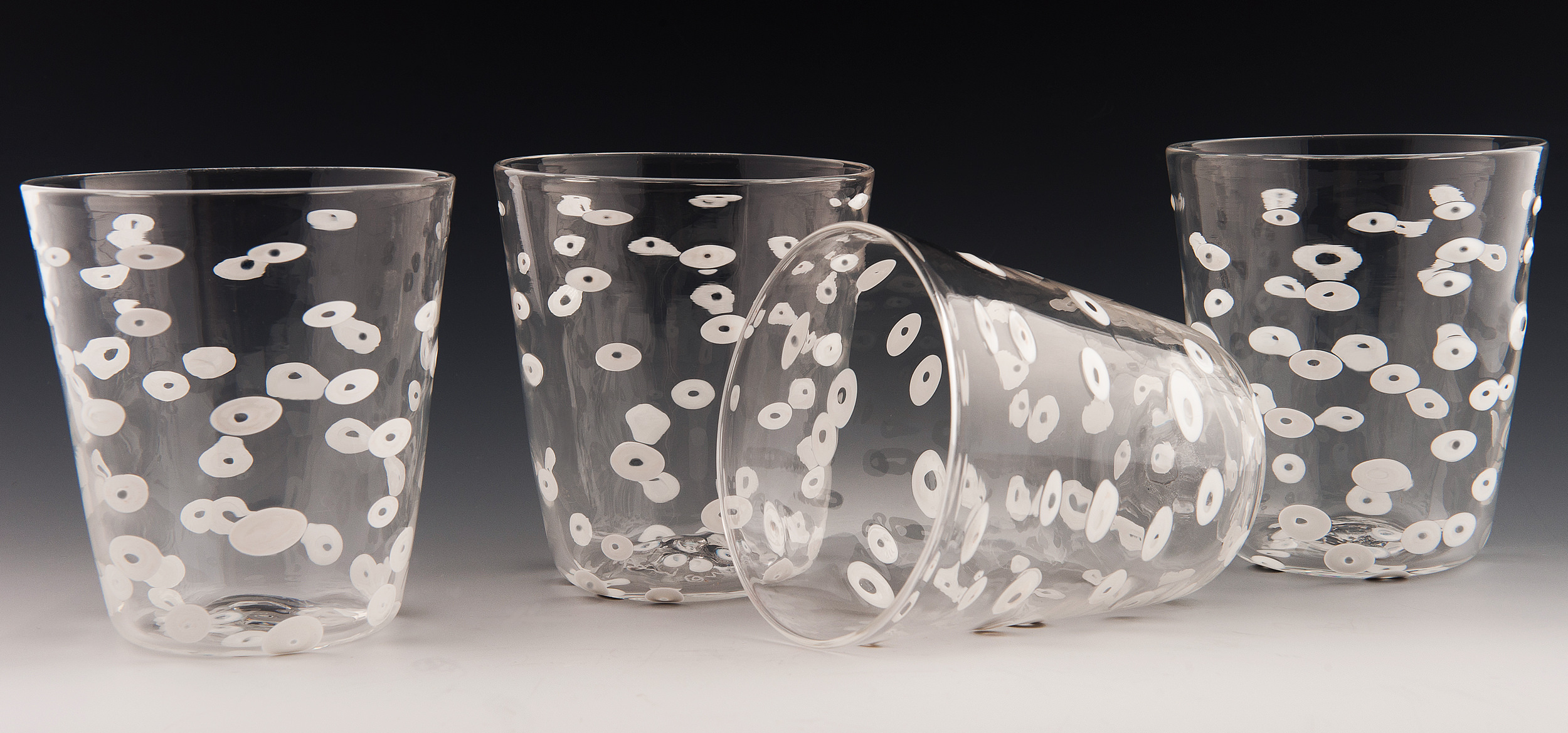 O Tumblers seen here in clear glass with white circles.