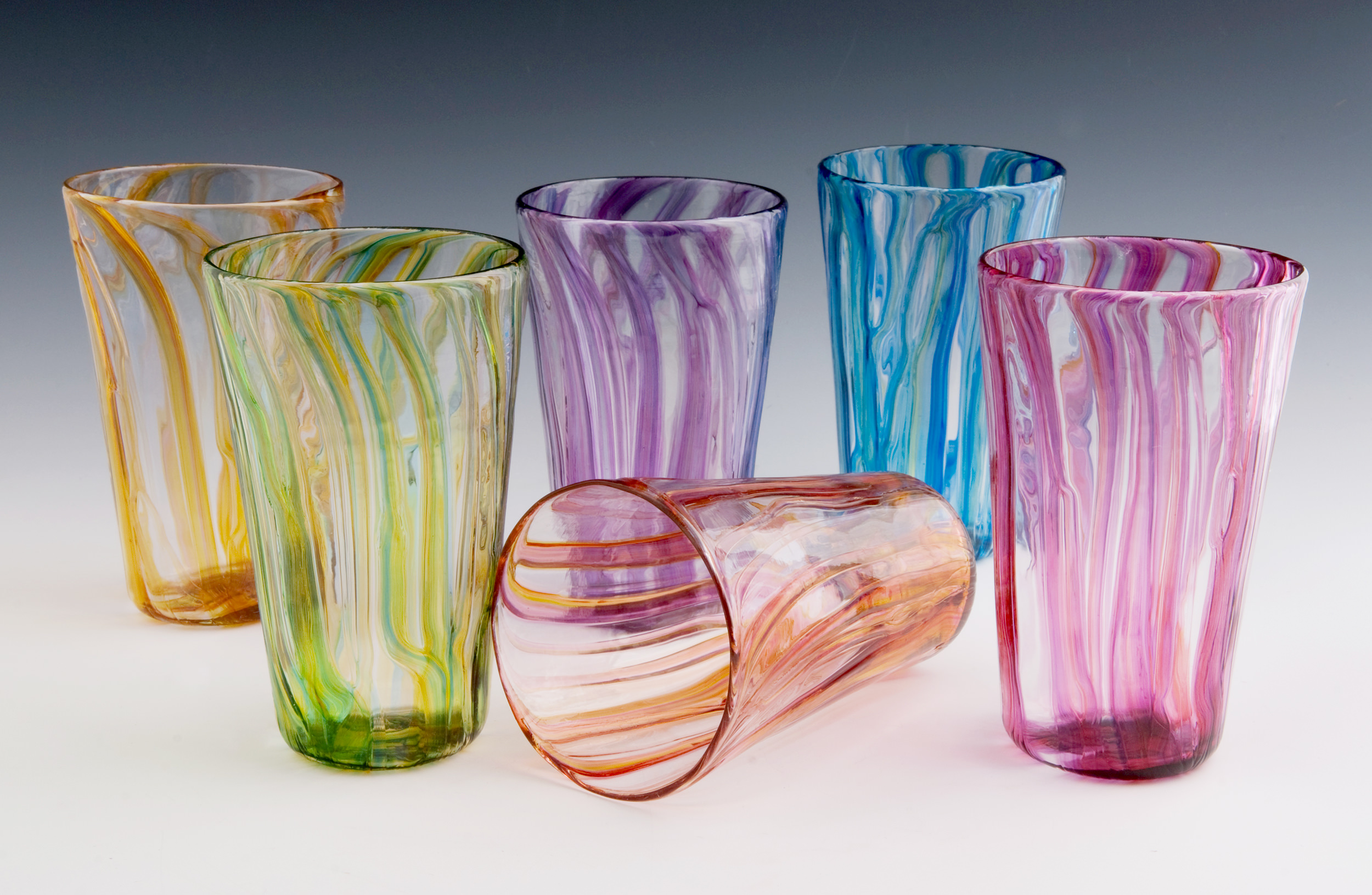 River Pint Glasses seen here in Gold, Lime, Purple, Peach, Blue, and Red Ribbons (left to right).