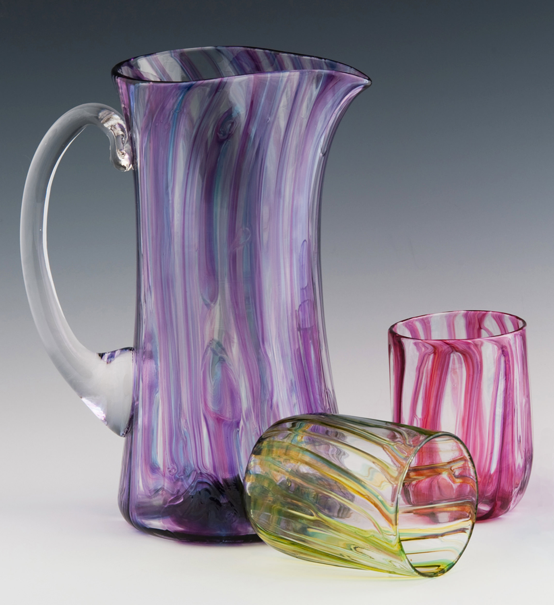 River Pitcher seen here in Purple Ribbons, tumblers shown in Lime and Red Ribbons.
