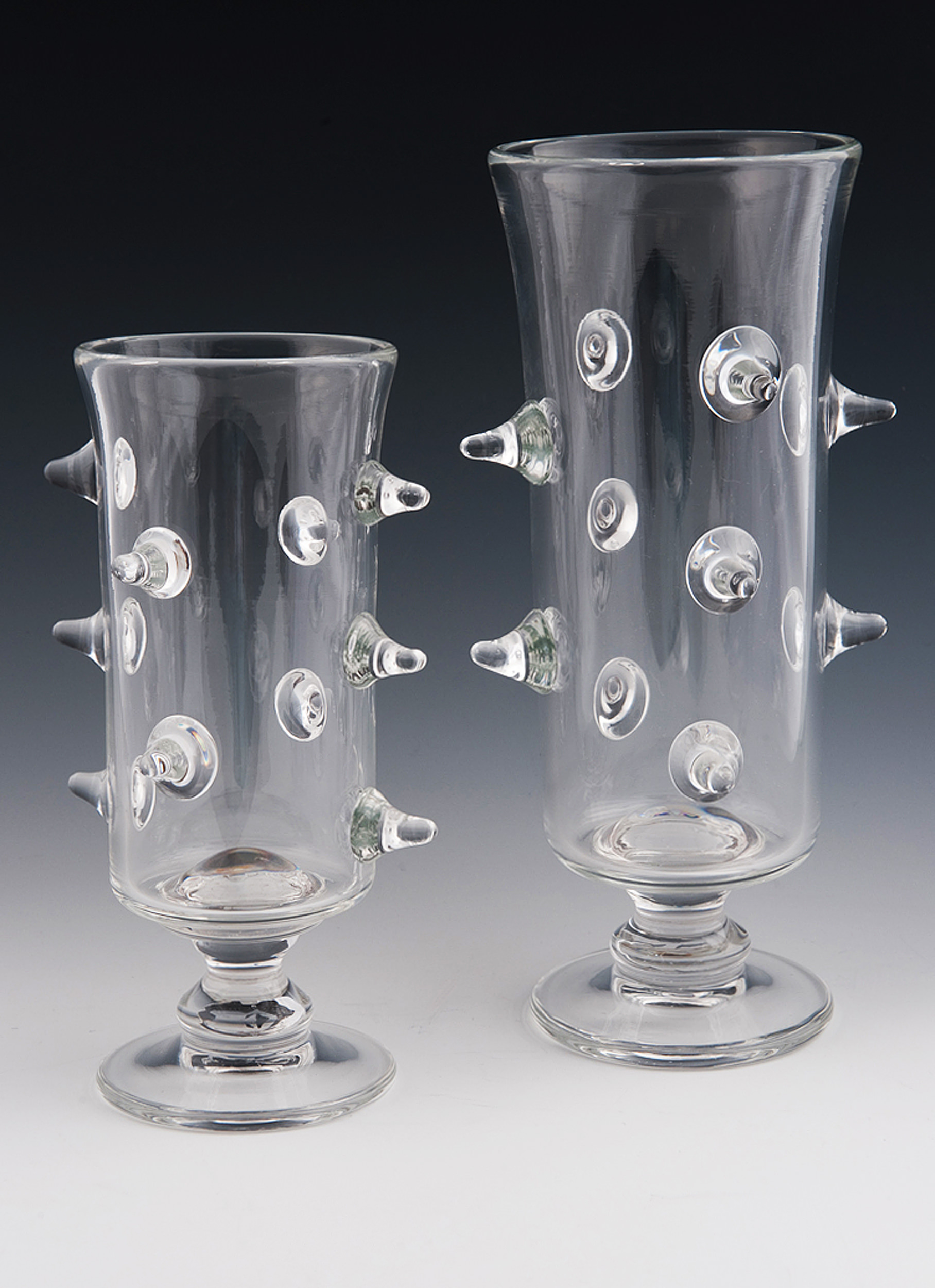 """Prunted Vases, clear vases with """"prunts"""" coming off the sides."""