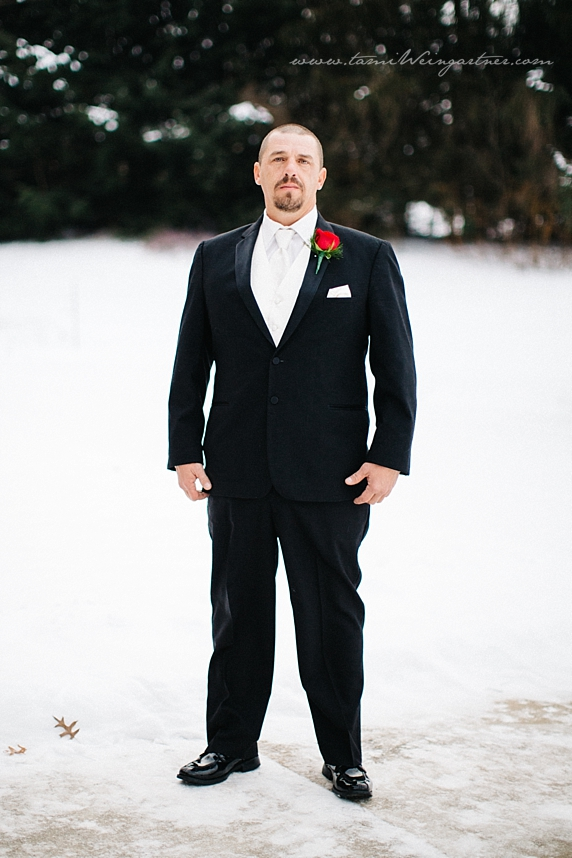 Black tux and white tie on groom for December wedding