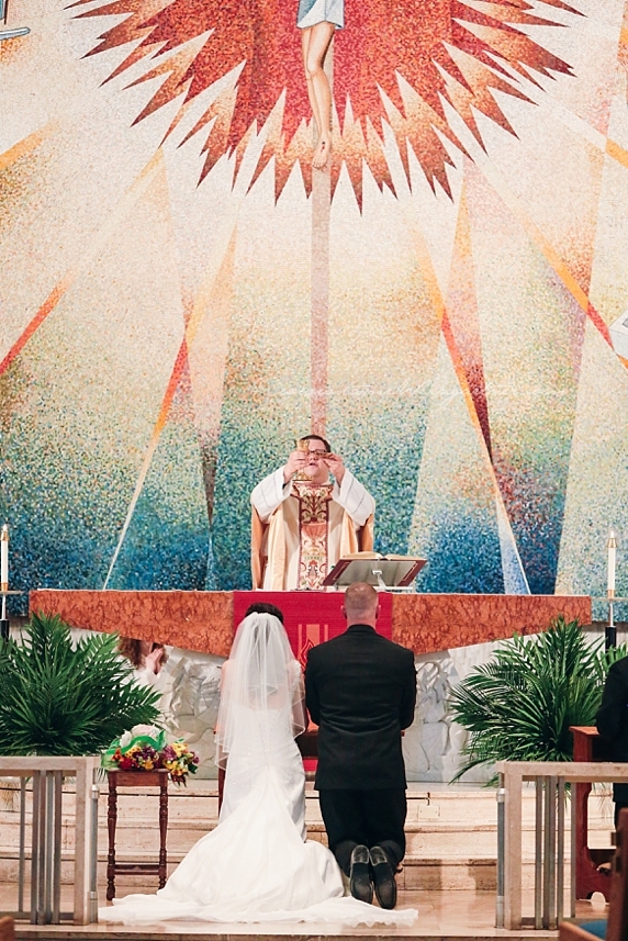 Consecration of the host during catholic wedding mass