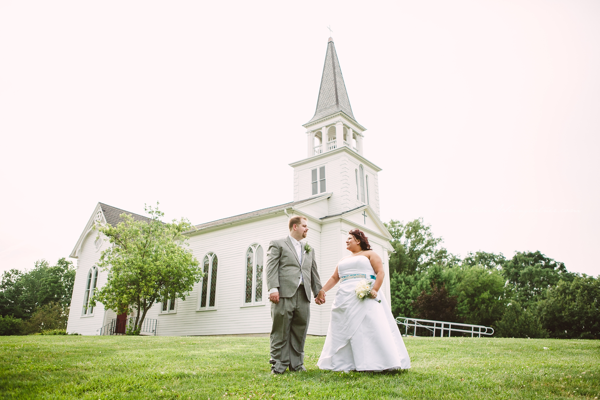 Bride and Groom outside of St. James Meeting House in Boardman Park
