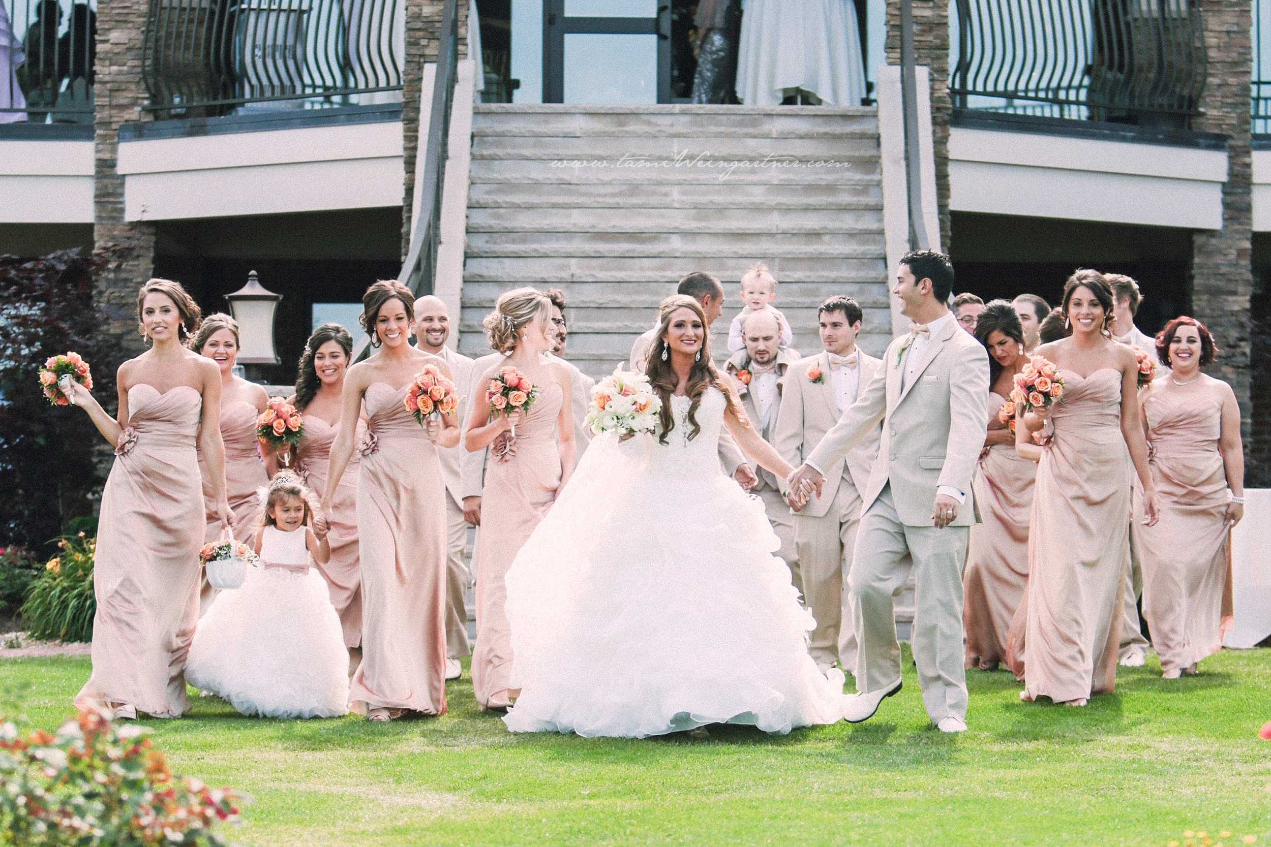 Bridal party in front of the terrace at the lake club in youngstown oh